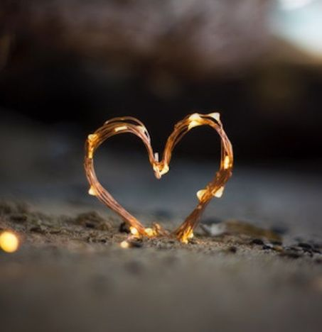 354160-Lit-Heart-In-The-Sand
