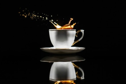 coffee-splashes-white-cup-black-background_8353-1511(1)