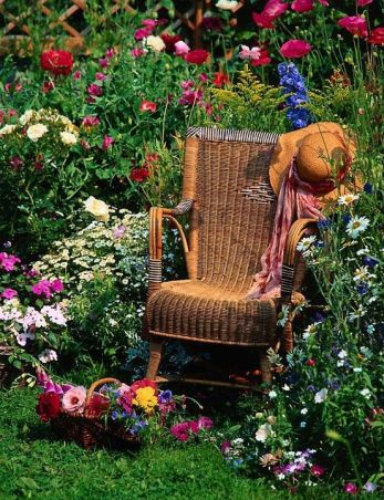 305799-Antique-Wicker-Rocking-Chair-In-A-Flower-Garden